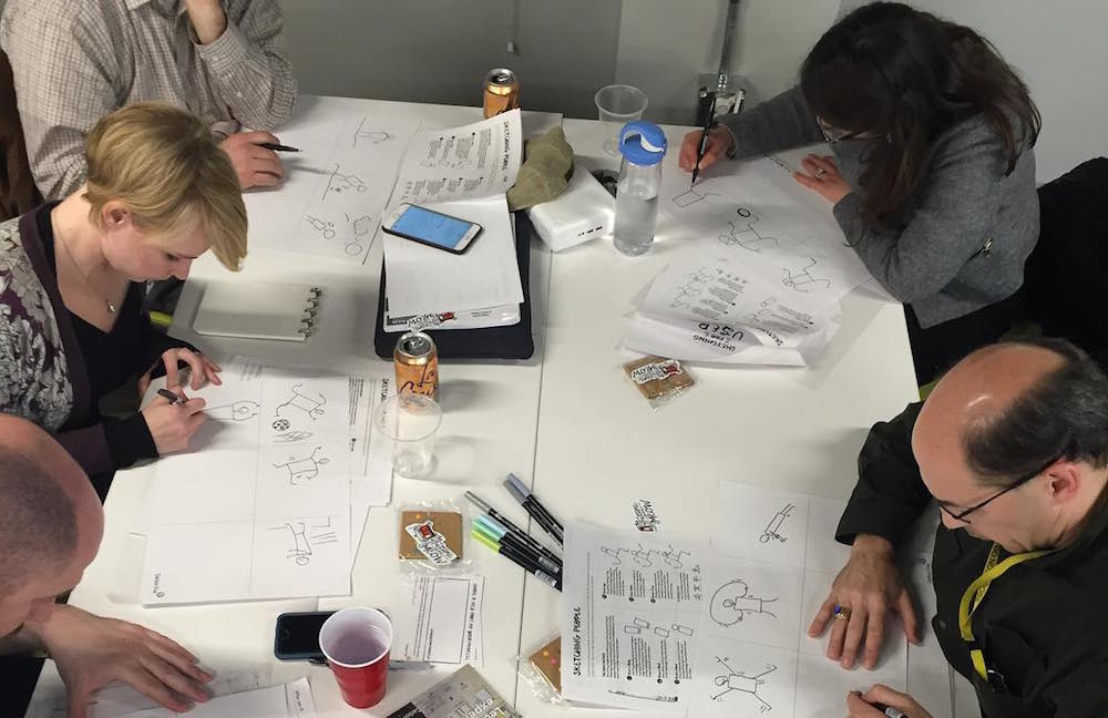 A group of people sketching
