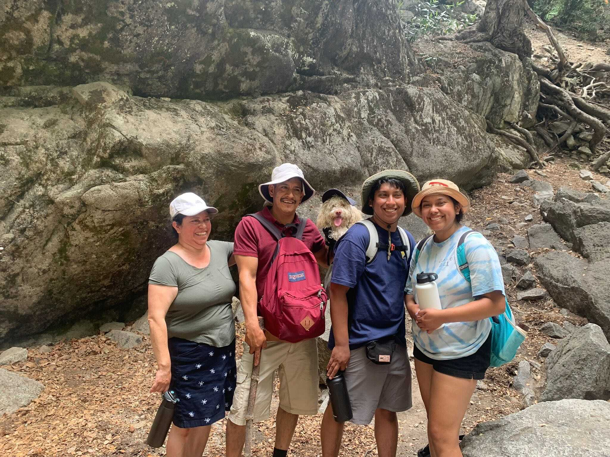 Carbon Five Software Engineer - Isai Lopez in blue tshirt hiking with mother, father, sister, and family dog in Yosemite