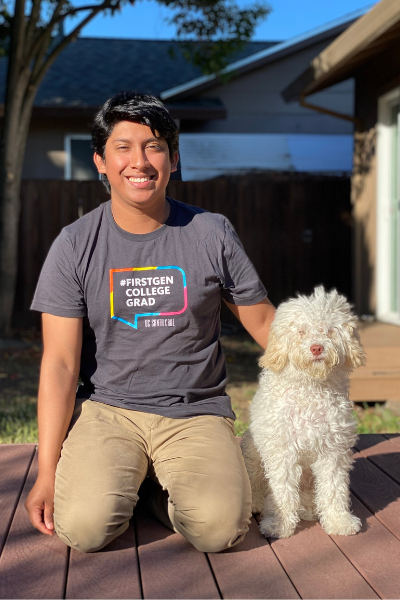 Isai Lopez Rodas kneeling with white curly hair dog, Teddy